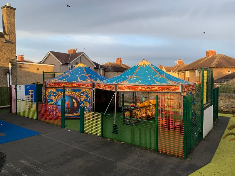 Two incredibly illustrated hexagonal gazebos create the Rocks Showman's Booth - a mobile museum, theatre, gallery and classroom