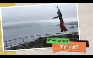 screenshot of the geology documentary film 'what's beneath our feet' - The rock showman walks upon whisky bottles atop an archaeological site in the Shetland Isles