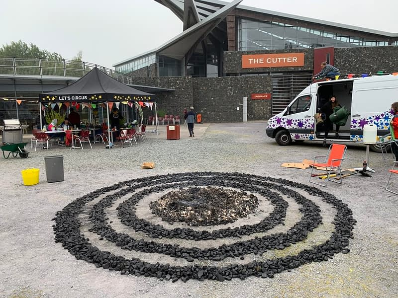 Three rings and a circle of coal laid out on the floor of Woodhorn Colliery make a sculpture during an artist residency